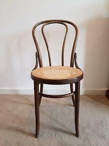 Lovely dark timber bentwood chair with woven base