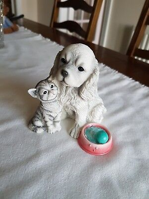 A Brand-new Leonardo figurine of a dog and cat.