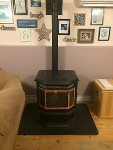 Quadra fire pellet stove for sale, complete and running