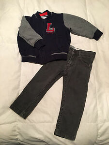 Lacoste zip up with Grey Jeans