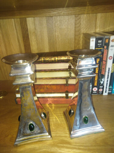 A pair of Arts and Crafts candlesticks, signed, with Ruskin/cabachons Glasgow