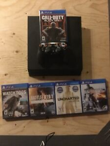 ps4 with 5 games and a controller