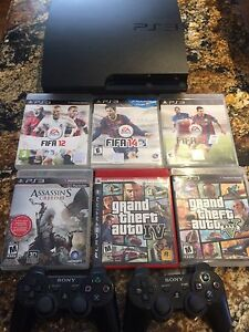 PS3 slim 500 GB 2 controllers 6 games all cables included