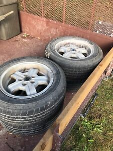 SNOW TIRES AND VOLVO WHEELS!    195/65/r15's. FREE!
