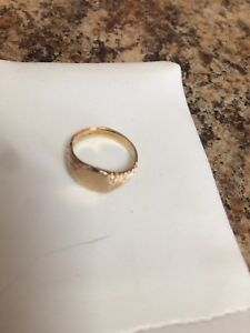 Child sized pinkie signet ring 10 k real gold.