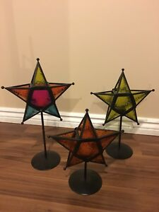 Three star candle holders