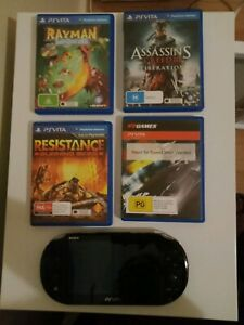 PS Vita Concole and 4 Games