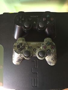 500gb PS3 with 2 controllers and 2 games