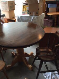 Oak dining table with walnut stain with 4 matching chairs.