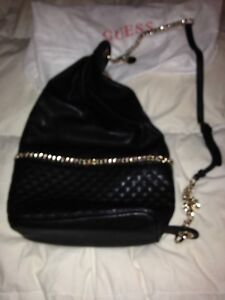 Guess black purse with gold detailing Brand new