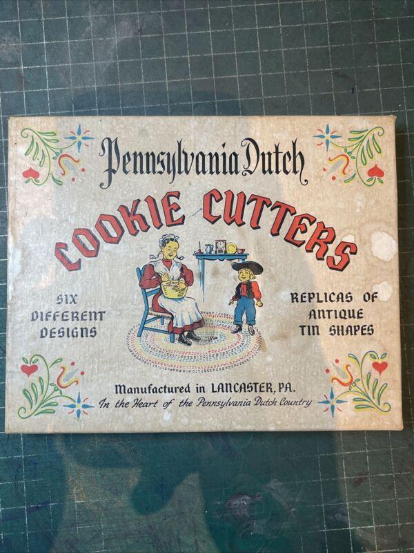 Vintage Pennsylvania Dutch cookie cutters in original box (6)
