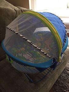 Covered outdoor/indoor bassinet$30