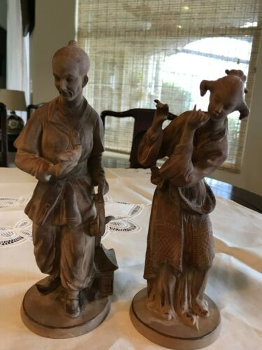 A pair of Japanese brown pottery figurines