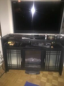 TV and TV cabinet with fireplace.