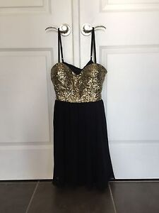 Very cute sparkly gold and black dress size S