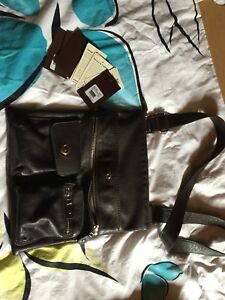 Roots dark brown leather purse