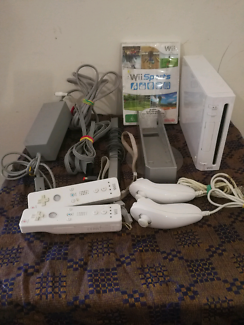 Wii console with controllers and wii sports