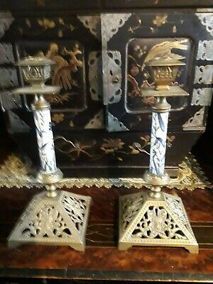 AESTHETIC MOVEMENT BRASS AND PORCELAIN CANDLESTICKS.