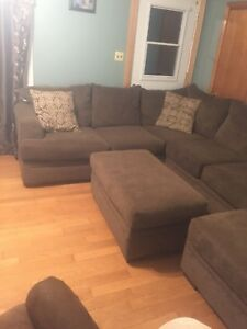 Year old sectional in like new shape with ottoman