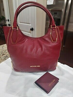 Michael kors beautiful red handbag and small deep red wallet set