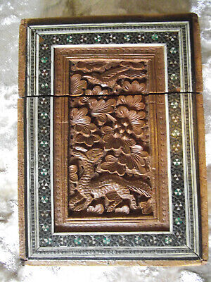 Sadeli work card case with carvings of creatures and foliage