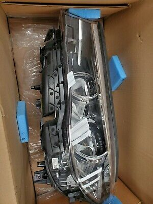 2019 Bmw 7 Series Left Headlamp G12 Part# 63117408711, Has small scar see pics 2