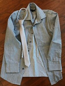 Boys size 8 button-up shirt and zipper tie.  Like new. $12