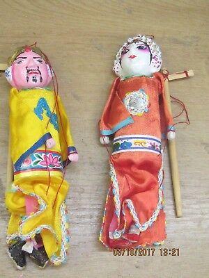 2 chinesische Marionetten