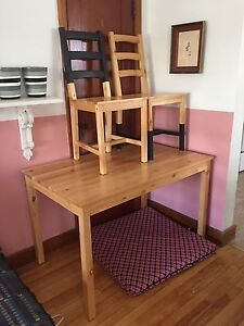 Wood dining set with painted accents
