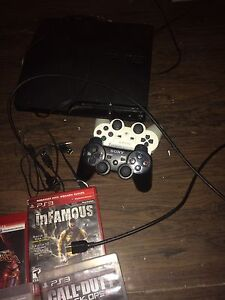 PS3 two controllers and games London Ontario image 8