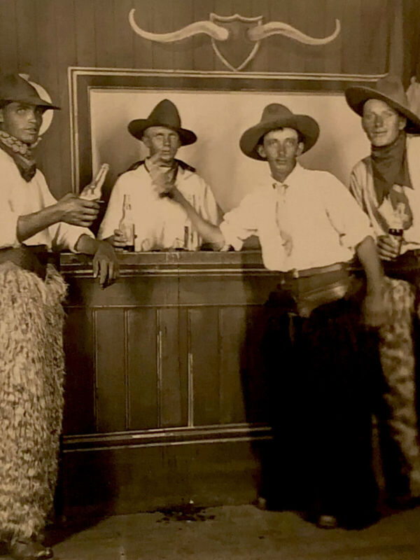 African American Cowboy at Saloon With  White Cowboys Having Beers Photo