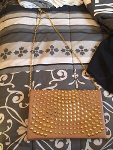 Nude clutch with studs