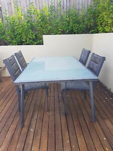 Frosted glass outdoor dining table and 4 chairs