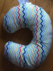 Boppy nursing pillow with 3 extra covers