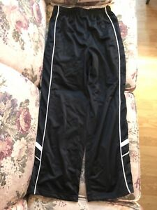 Black large boys track pants with white stripe down side