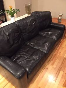 Black leather couches and chaise and hutch