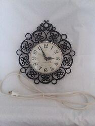 vtg GE wall clock retro black scroll kitchen electric analog Model 2151 works