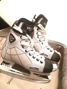 Boys hockey skates and adult replacement stick blades