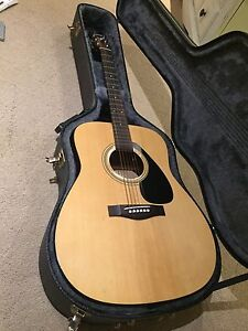 ACOUSTIC GUITAR With hard case, capo, tuner, picks & chord book