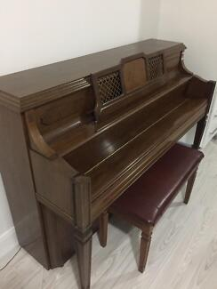 Upright piano, shoe cabinet, refrigerator