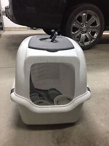 Cat litter box, pet cage and full box of cat litter