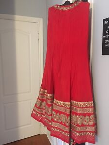 Stunning Gold and coral red lengha