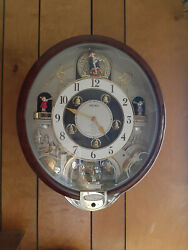 Seiko melody in motion wall clock, eight Beatles songs. Model QXM134BRH