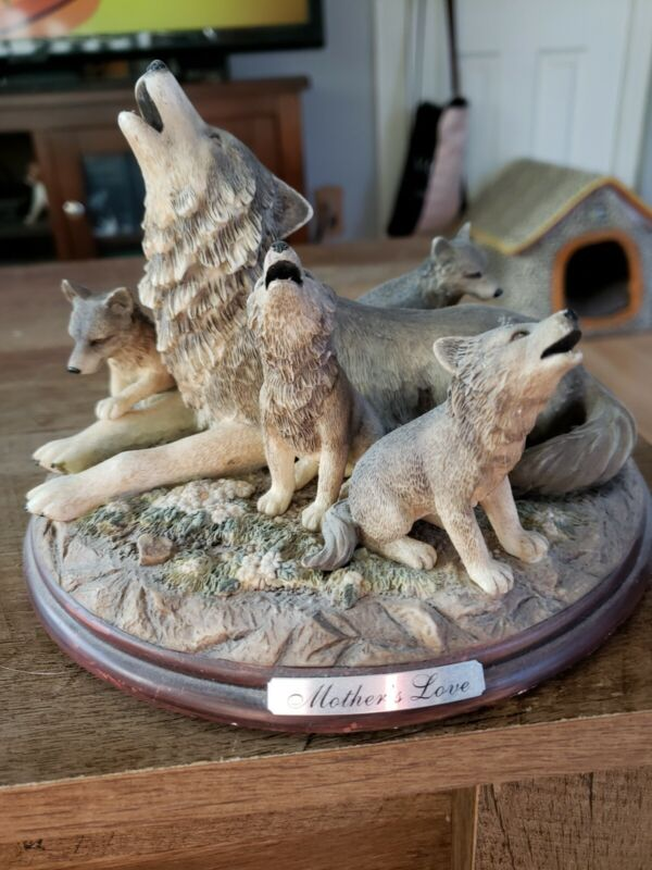 MOTHER WOLF WITH PUPS STATUE