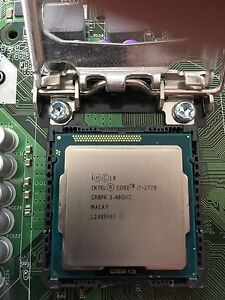 Intel core i7 3770 with motherboard and wifi chip