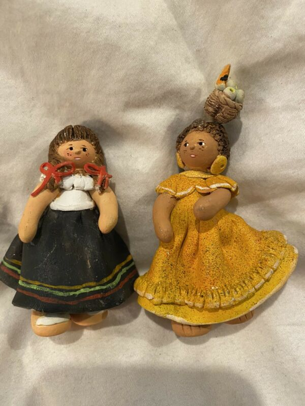 Set Of 2 Clay Souvenier Girl Figurines