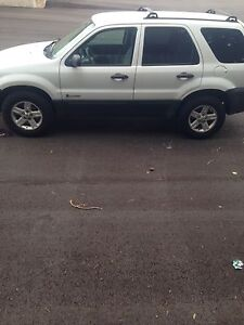 2006 Ford Escape 4wd. With safety.