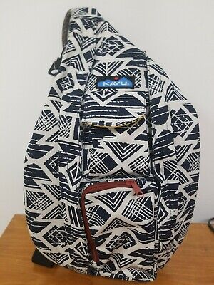 Kavu white and navy design with copper color zipper rope sling bag.
