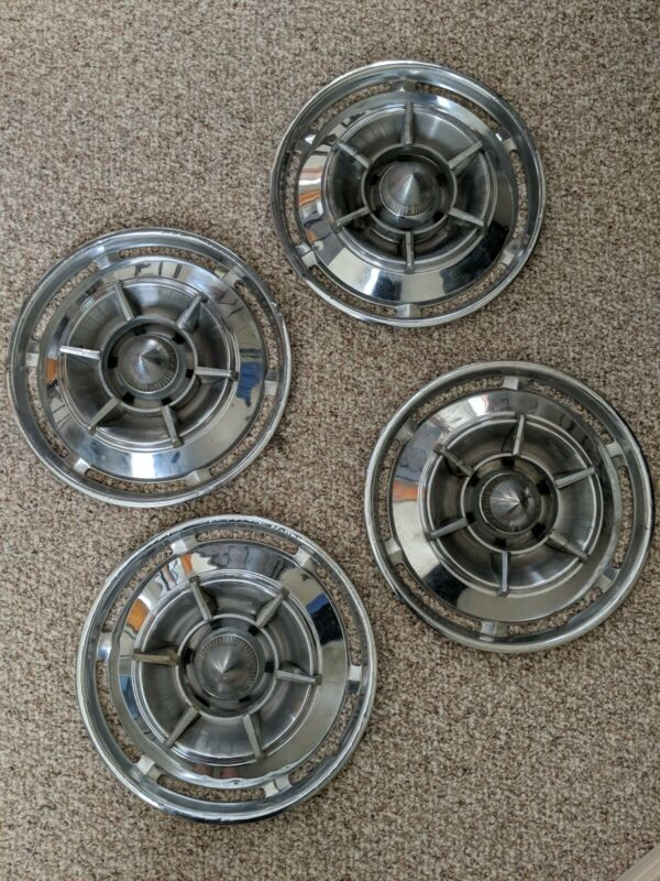 Set of 4 vintage chrome hubcaps with mid-century bullet design