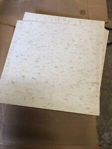Composite floor tile